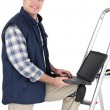 Tiler stood with ladder and laptop — Stock Photo #17473753
