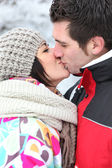 Couple kissing during winter holiday — Stock Photo