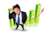 Businessman in front of a bar chart — Stock Photo