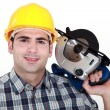 Workmwith circular saw — Stockfoto #17618669