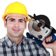 Stock Photo: Workmwith circular saw