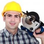 Workman with a circular saw — Stock Photo