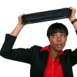 Scared office worker shielding themselves with keyboard — Stock Photo