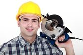 Workman with a circular saw — Stock Photo