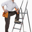 Stock Photo: Worker with stepladder