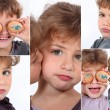 Stock Photo: Little girl covering eyes with eggs
