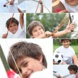 Mischievous little boy playing outdoors - Stock Photo
