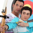 Teen practicing archery — Stock Photo