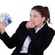 Stock Photo: Female entrepreneur holding bunch of bank notes
