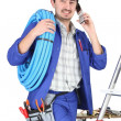 Plumber with materials, toolbox and cellphone — Stock Photo #17624141
