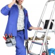 Stock Photo: Tradesmwith his tools and stepladder