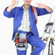 Plumber showing cell phone — Stock Photo #17624147