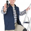 Stock Photo: Tiler holding cell phone