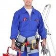 Stock Photo: Electrician posing by his equipment