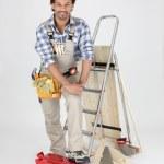 Carpenter with equipment, studio shot — Stock Photo
