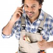 Carpenter receiving good news over the phone - Stock Photo