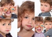 Little girl covering eyes with eggs — Stock Photo
