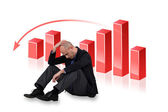 Depressed businessman with a downward chart — Stock Photo