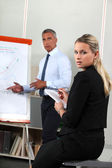 Business looking at a flipchart — Stock Photo