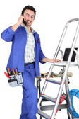 A tradesman with his tools and a stepladder — Stock Photo