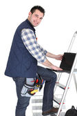 Electrician stood by step ladder — Stock Photo
