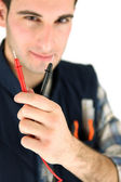 Electrician holding probes from voltmeter — Stock Photo