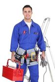 Electrician posing by his equipment — Stock Photo
