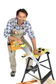 Man sawing a plank of wood — Stock Photo