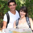 Stock Photo: Young couple orienteering