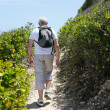 Senior mhiking by coast — Stock Photo #18406927