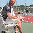 Stock Photo: Tennis player on bench
