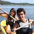 Teenagers kayaking — Stock Photo