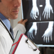 Stock Photo: Doctor looking at X-ray