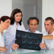 Hospital staff looking at an x-ray — Stock Photo