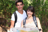 Young couple orienteering — Stock Photo