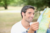 Man looking at map — Stock Photo