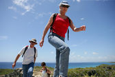 Group of senior persons hiking by a sunny day — Stock Photo