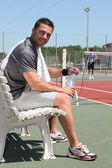 Tennis player on the bench — Stockfoto