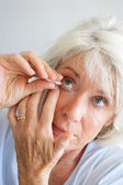Senior woman with eye drops — Stock Photo