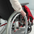 Elderly person in wheelchair - Stock Photo