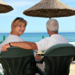 Couple at a seaside cafe — Stock Photo