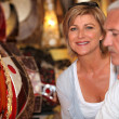 Stock Photo: Mature couple in antique shop