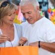 Stock Photo: Mature couple looking at bag