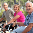Middle-aged on bike ride — Stock Photo