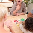 Family playing a board game - Stock Photo