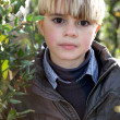 Boy in a garden — Stock Photo