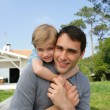 Father giving his son a piggy back — Stock Photo
