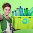 Stock Photo: Womrecycling plastic bottles