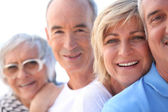 Head and shoulder shot of two mature couples — Stock Photo