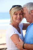 Mature couple in a loving embrace — Stock Photo